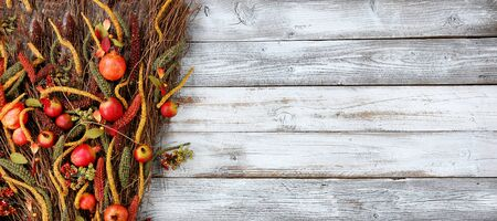 Thanksgiving decorations on left side of white rustic wood