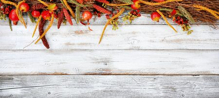 Thanksgiving decorations on top portion of white rustic wood