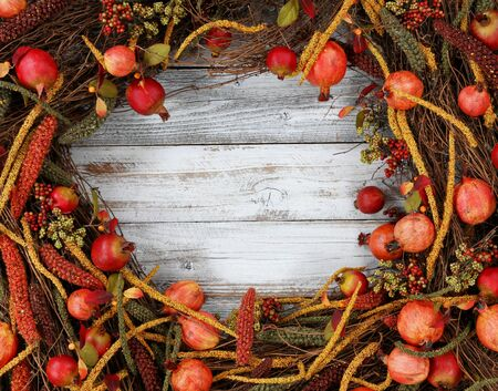 Thanksgiving autumn decorations in circle border on white rustic wood