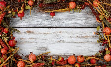 Thanksgiving autumn decorations in rectangle border on white rustic wood 版權商用圖片