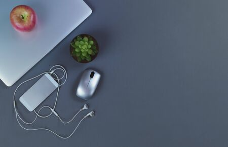 Gray desktop with mobile devices in flat lay format for telework or telecommute concept