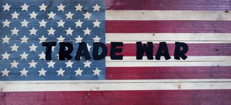 Text letters spelling trade war on vintage wooden United States flag 版權商用圖片