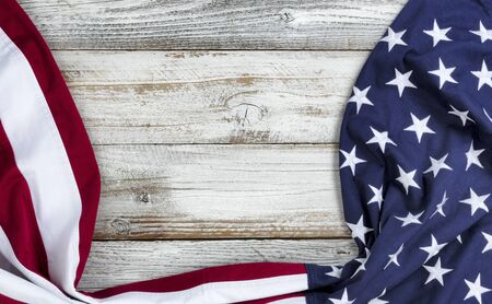 Draping United States flag on bottom and side borders of white rustic wooden background  版權商用圖片