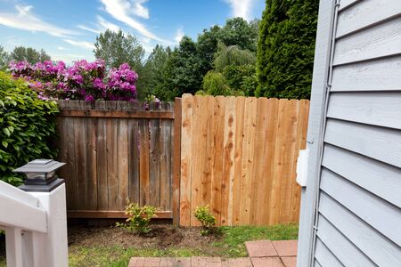 Side by side comparisons of new and old wooden cedar fence