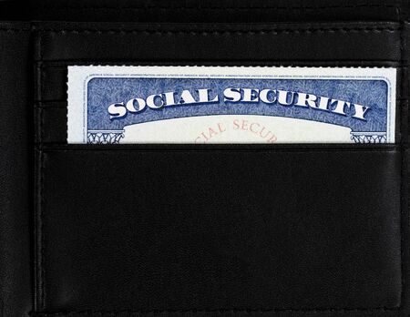 United States Social Security card inside of leather wallet 版權商用圖片