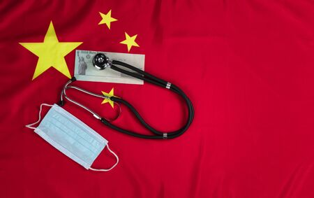 Chinese national flag with United States stimulus check and medical equipment for Covid-19 concept