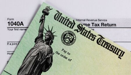 IRS refund check and tax form in close up view