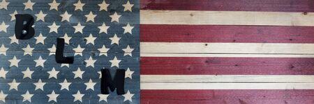 BLM letters on United States vintage wooden flag for black lives matter concept