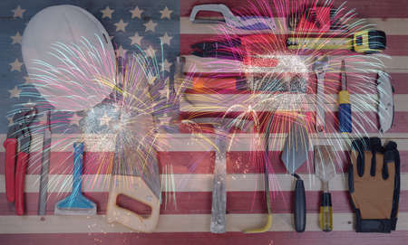 Labor Day holiday background for United States of America with worker tools and US flag with fireworks