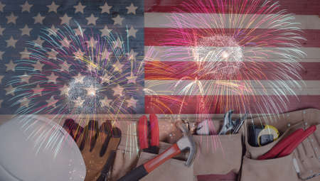 Labor Day background with hand tools and fireworks for the holiday celebration Banco de Imagens