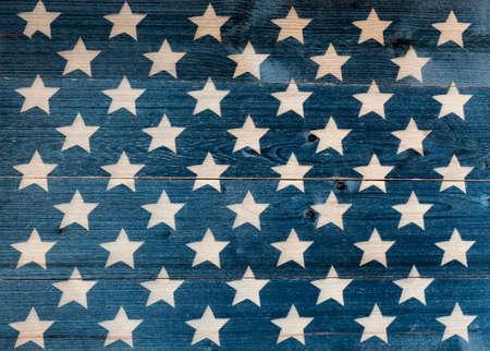 White stars on dark blue wooden board background
