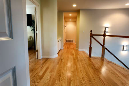 Newly installed red oak floor boards for hallway in home