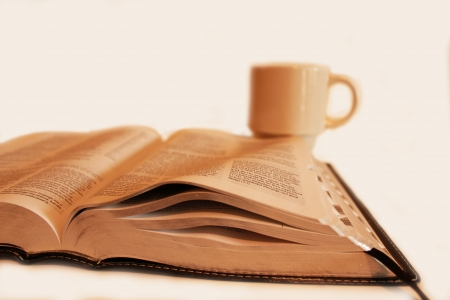 religious habit: Book and coffee cup isolated on a white background