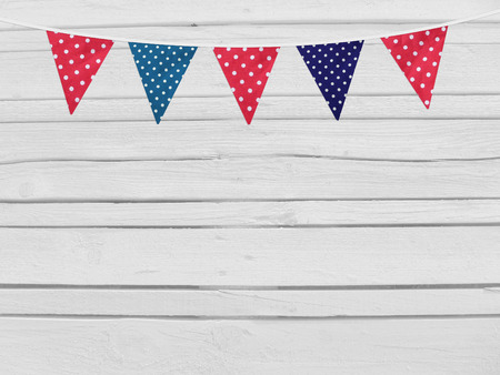 birthday decoration: Birthday, baby shower mockup scene. Party flags decoration. Wooden background. Empty space for your text, top view. Stock Photo