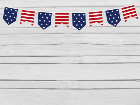 white flag: Party flags on wooden background. 4th July, Independence day, card, invitation in usa flag colors. Top view, empty space.