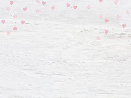 feminine background: Valentines day or wedding mockup scene paper hearts confetti and empty space for text. Grunge white background, flat lay image. Top view. Stock Photo