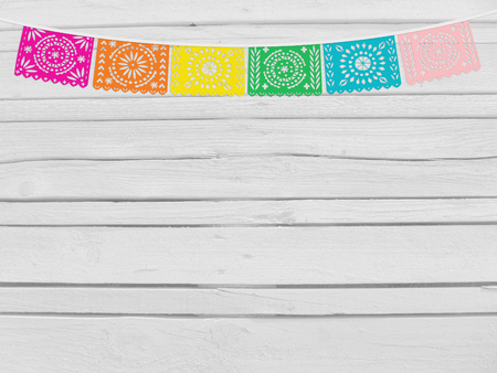cut paper: Brazilian june party, festa junina mockup. Birthday decorative scene. String of handmade cut paper flags. Party decoration. White wooden background, empty space. Top view.