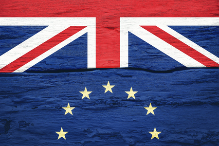 Brexit concept. Flags of the United Kingdom and the European Union on cracked grunge wall background. Possible exit of Great Britain from the EU.