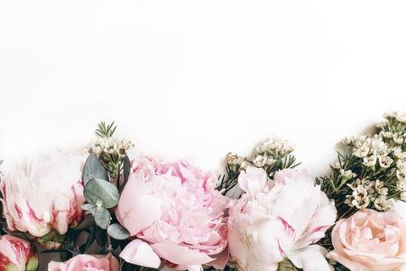 Decorative web banner made of beautiful pink peonies, rosies and eucalyptus isolated on white background. Feminine floral frame composition. Styled stock photo.Empty space. Flat lay, top view. Stock fotó