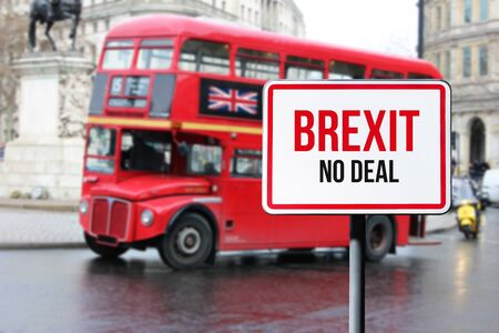 Blurred London street view with red double decker bus and Brexit no deal sign in rainy day. Possible exit of Great Britain from the EU. Brexit concept.