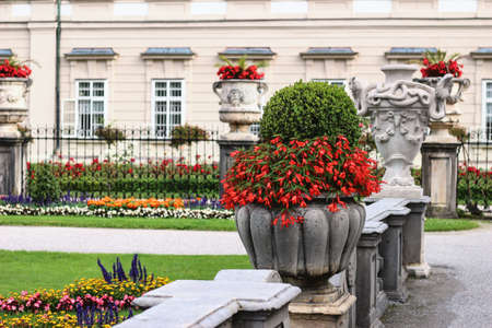 baroque gardens in town centre. Blurred ornamental flowerbeds and decorative statues stone vase. Stock fotó
