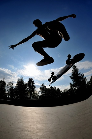 halfpipe: skateboard action at the local skate park  Stock Photo