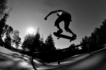skateboarding: silhouette of a skateboarder in action  Stock Photo