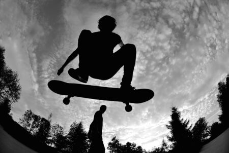 silhouette of a skateboarder in action  photo