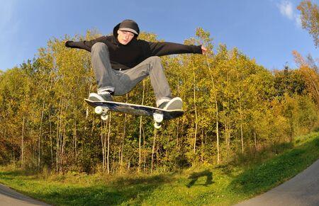 halfpipe: skateboarder having fun at the local skate park Stock Photo