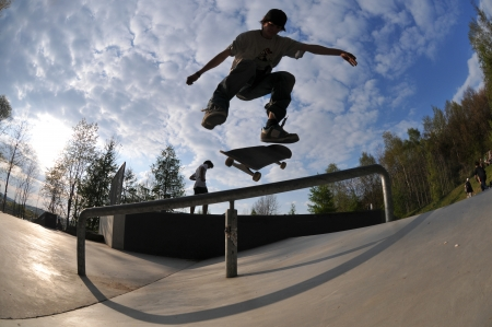 skateboarding: skateboarder having fun at the local skate park Stock Photo