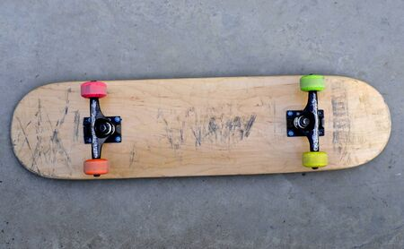 youth culture: blank skateboard on the ground