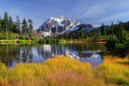 Picture lake reflecting Mount Shuksan on a beautiful autumn day in Washington State