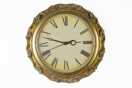 Clock face of historical wall clock with golden frame photo