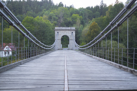 Old chain bridge over the river Luznice in the Czech republic photo