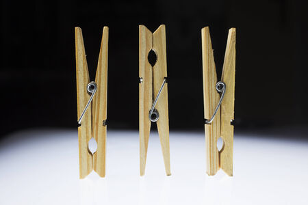 clothepeg: Wooden clothes pegs on a white background