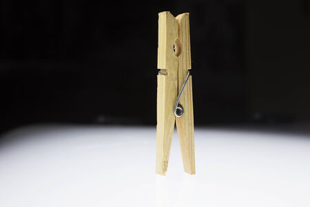 clothepeg: Wooden clothes peg on a white background