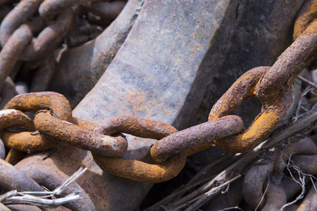 Part of an old rusted chain on a riverside