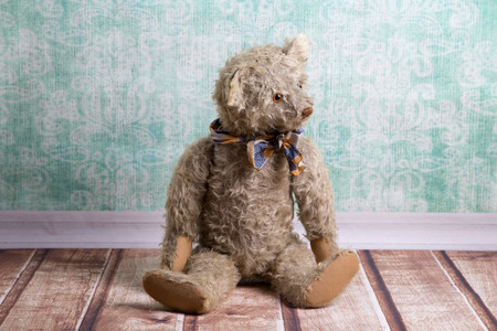 cute teddy bear: Unsightly sitting vintage Teddy bear