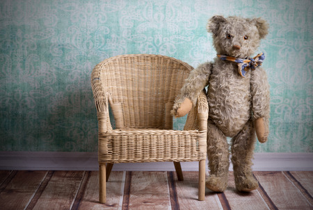 unsightly: Unsightly vintage Teddy bear with wicker chair