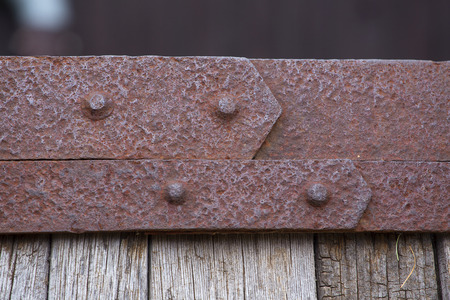 ironworks: Rusty ironworks on a wooden barrel