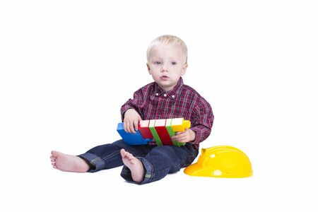 blond boy: Two years old boy playing with cubes