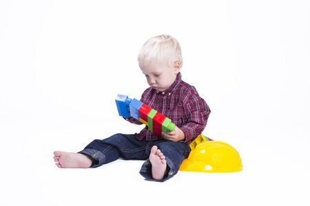 two years: Two years old boy playing with cubes