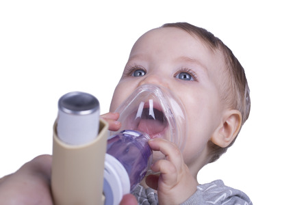 one year old: One year old boy using an asthma inhalator