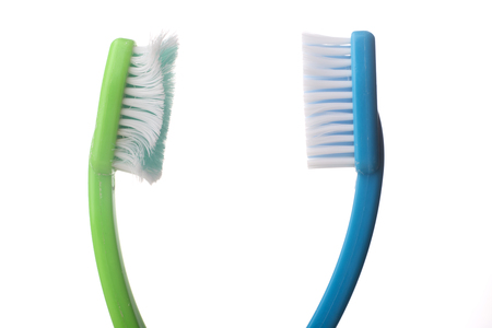 dirty teeth: Used old tooth brush and new tooth brush on a white background