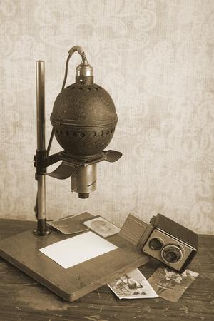 darkroom: Historical photographic enlarger and vintage camera, darkroom equipment, sepia tone