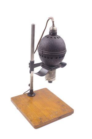 darkroom: Historical photographic enlarger, darkroom equipment on white background Stock Photo