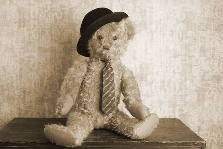 bowler: Vintage teddy bear with bowler hat and tie, sepia tone