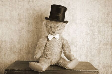 shabby: Vintage teddy bear with top hat and bow tie, sepia tone