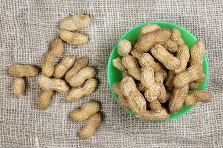 Peanuts in a green cup, healthy food