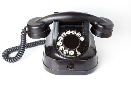 Vintage black telephone on a white background